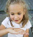Girl holding ladybug