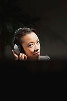 Business woman wearing headphones
