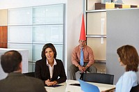 Business meeting with dunce sat in corner