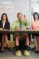 Businessman in meeting with no trousers on