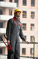Worker with working clothes and pliers. Housing construction, apartments. San Sebastian, Gipuzkoa, Euskadi. Spain.