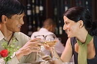Couple toasting in restaurant