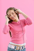Girl listening to music with headset