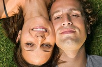 Close up portrait of couple head to head