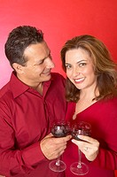 Hispanic couple drinking red wine