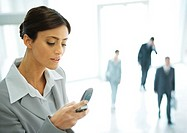 Young businesswoman checking phone