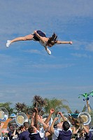 Cheerleader flying during a college parade in San Diego, California.