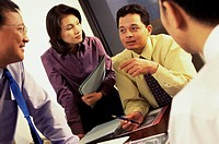 Businesswoman with three businessmen talking in an office