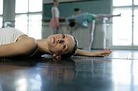 A female ballet dancer lying on the floor
