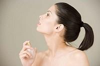 Girl spraying perfume