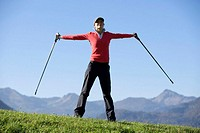 Austria, alps, young woman exercising, low angle view