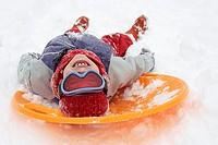 Boy lying on a sled
