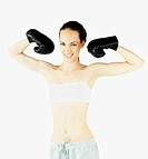 Female boxer flexing her muscles