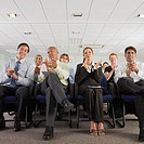Business people clapping in conference