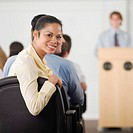 Businesswoman smiling in conference
