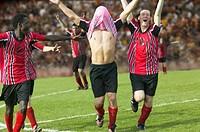 Soccer team celebrating their goal
