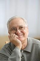 Older man daydreaming