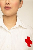 Nurse with a red cross on her chest