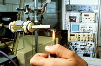 Close-up of a person´s hand lighting a cigarette on a testing machine in a manufacturing plant, Richmond, Virginia, USA