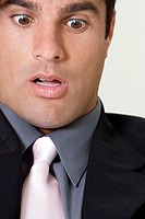 Close-up of a businessman looking shocked
