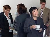 Office workers having a coffee break