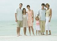 Group portrait on beach, full length