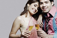 Portrait of a young couple holding champagne flutes