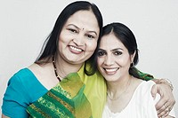 Portrait of two mature women holding each other