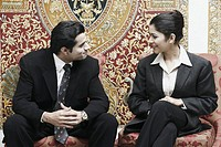 Close-up of a businessman and a businesswoman talking