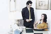 Businessman and a businesswoman in an office