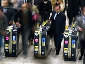 Commuters in the Japanese subway system in Tokyo, Japan