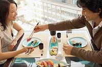 Couple sharing sushi