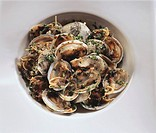Shellfish in garlic butter with onions