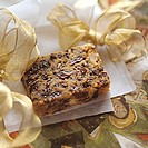 A piece of fruit loaf with wrapping paper and bows