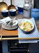 Sauerkraut strudel with bacon in roasting dish in rural kitchen