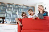 Father and his two children on a couch