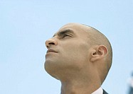 Man with shaved head, low angle view