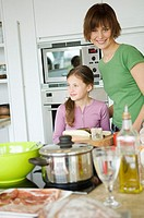 Woman and girl in kitchen