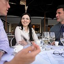 Friends having coffee at restaurant table, Perth, Australia