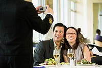 Couple having photograph taken at restaurant