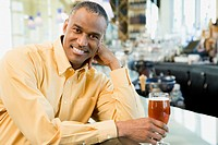 African American man with drink at bar