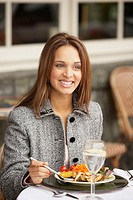 Businesswoman having lunch outdoors, Larkspur, California, United States