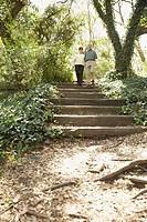 Hispanic couple walking down stairs outdoors