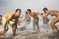 Friends Splashing in Surf