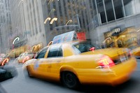 Yellow taxi cabs, blur, motion, movement, speed. Avenue of the Americas. Midtown Manhattan. New York. USA.
