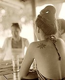 Back of woman at outdoor table