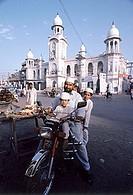 Pakistan, Punjab, Lahore, Family on motorcycle.