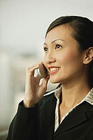 Young woman on mobile phone, smiling