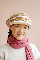 Young woman wearing cap, smiling, portrait