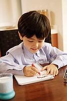 Boy drawing in notebook